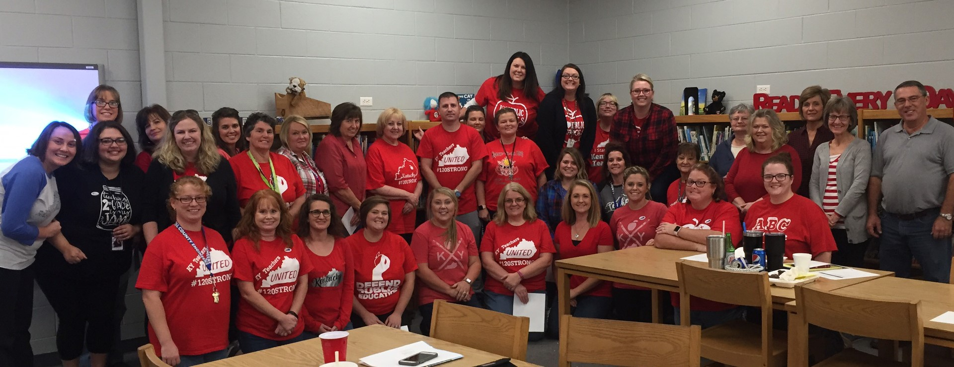 Staff wearing red in support of public education.